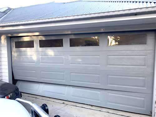 Vehicular impact on a garage door